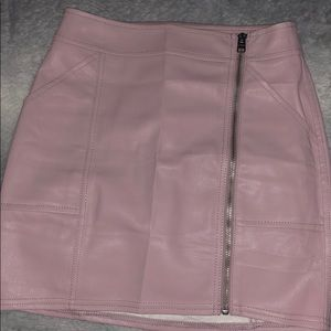 Faux leather, pink, mid-rise skirt.